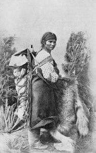 Navajo mother and her baby in a traditional papoose.
