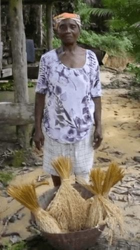French Guiana farmer displays her harvest.