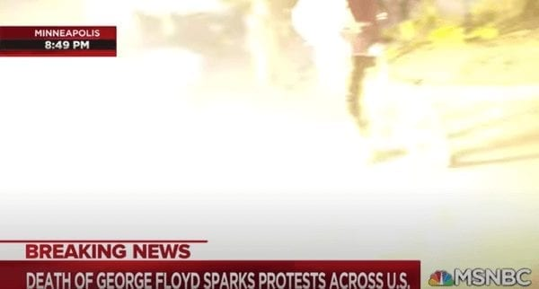 Flashbangs go off near protesters and journalists as they run from MN police.