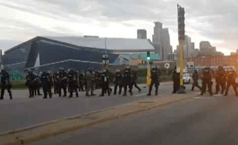 Minneapolis state troopers shoot rubber bullets at car full of journalists as they drive away.