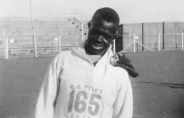 Edward Gardner appears on camera ahead of the Bunion Derby race wearing number 165.