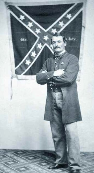 Marshall Sherman with the Confederate VA battle flag he captured