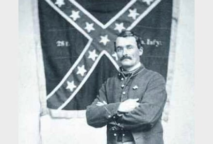 1st MN private Marshall Sherman with Confederate battle flag