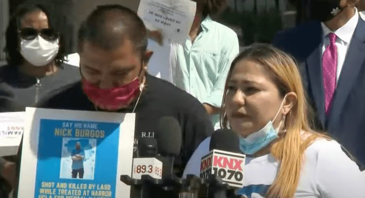 Nick Burgo's family speaks at a protest over his death